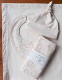 Simple Ivory Baby Cap, Bib, Burp Cloths Blanket with Grey and Orange Dots