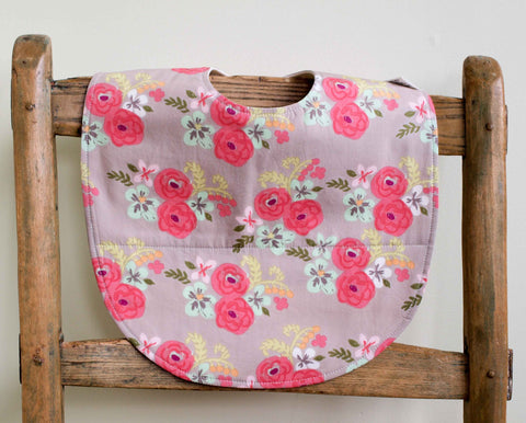Pink and aqua flowers baby bib