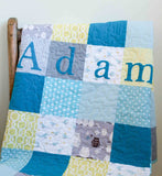 patchwork baby name quilt in organic cotton