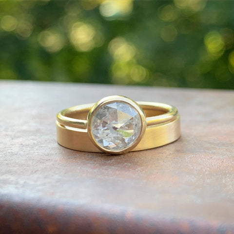 Custom designed engagement ring with recycled yellow gold