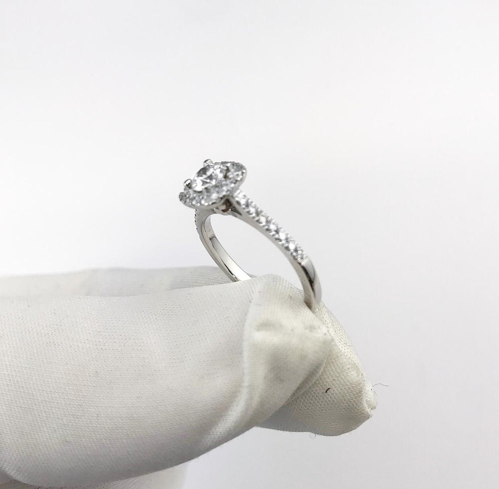 18ct White Gold Cushion Shape Halo With Round Brilliant Cut Centre Diamond Engagement Ring