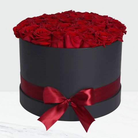 Box of Red Roses in Black Round Box