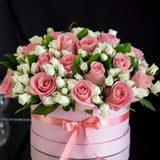 Beautiful Arrangement of Pink Roses and White Spray Roses in Round Pink Box