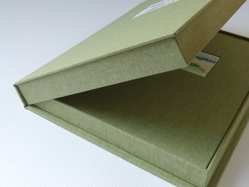 hand bound book of poems in drop back box