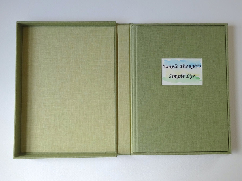 hand bound book of poems in open drop back box