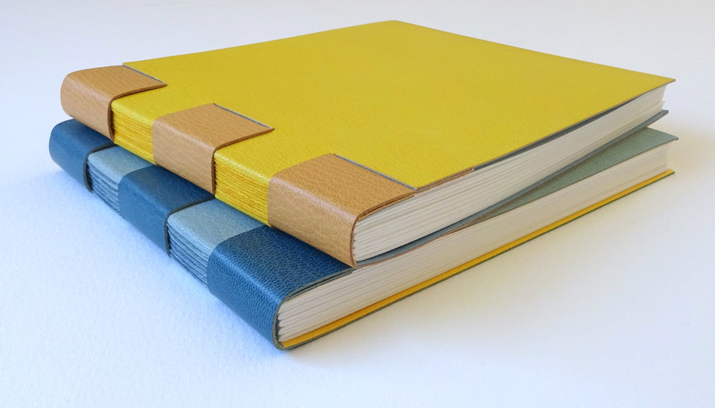 perfect bindings yellow and blue cross structure watercolour sketchbooks hand bound