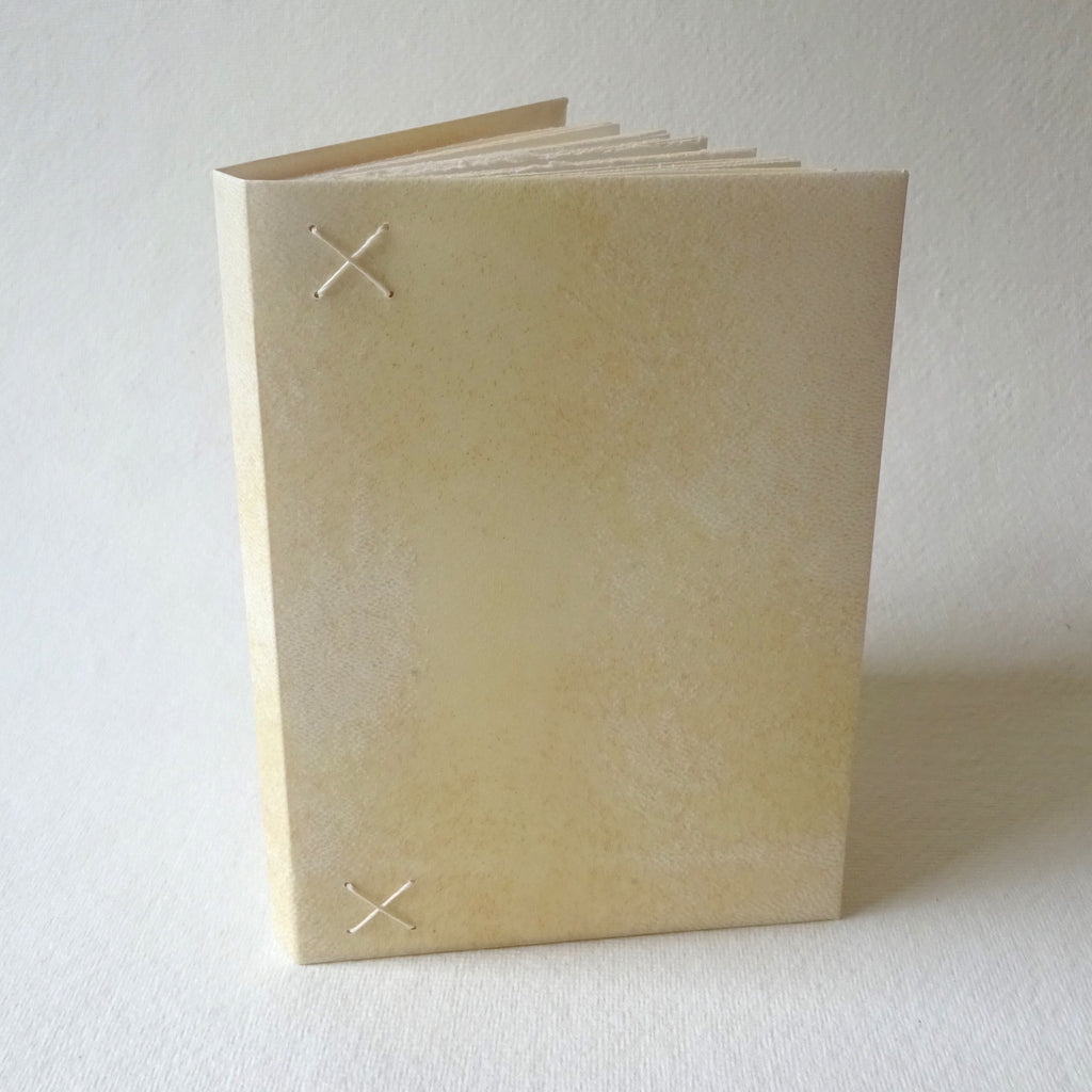 perfect bindings hand bound vellum notebook with cross stitch detail