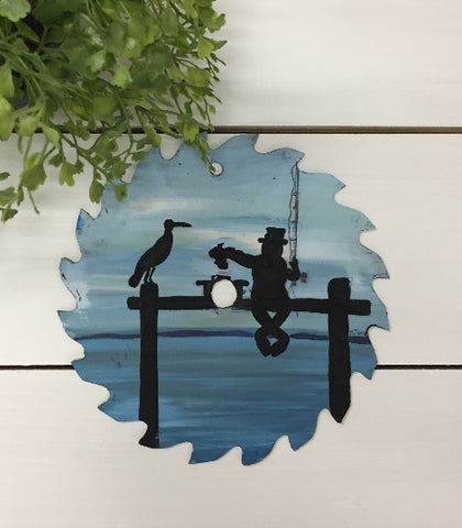 fisherman painting on saw blade