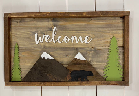 Welcome with mountains,trees and bear sign