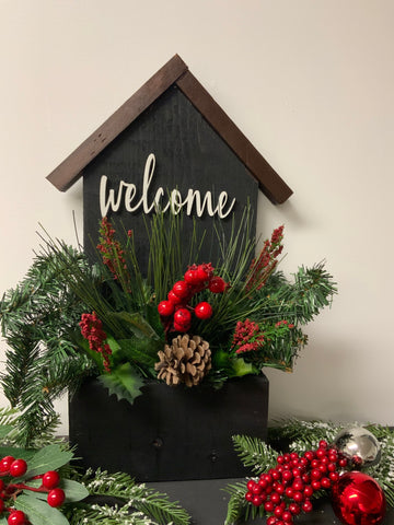 Welcome wooden house with artificial arrangement