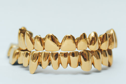 golden teeth grillz isolated