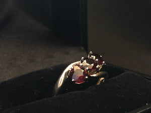 Contemporary gold 9ct rose 3 round garnet ring