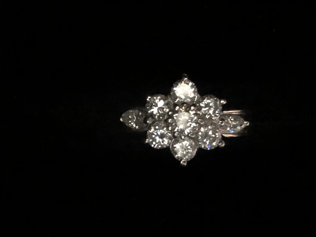 Contemporary 900 platinum flower  claw set diamond ring