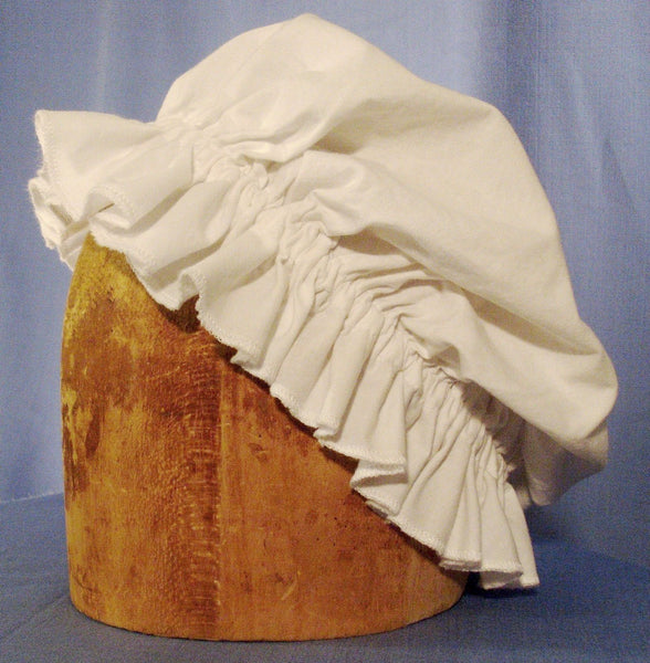 Mob Cap by White Pavilion Costumes, side view. This cap is perfect for living history reenactors in all eras from the medieval through the renaissance, 17th and 18th centuries, and into Victorian times. It's also a perfect accent for fantasy and fairytale costumes.
