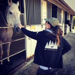 One of our clients rocking her Never Knock - Ride North Hoodie while strolling through horse country in California.