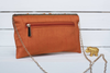Orange ADHĀ CADA purse