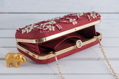 Maroon colored purse