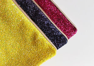 glitter clutch bag in yellow