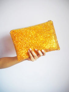 burnt orange glitter clutch bag