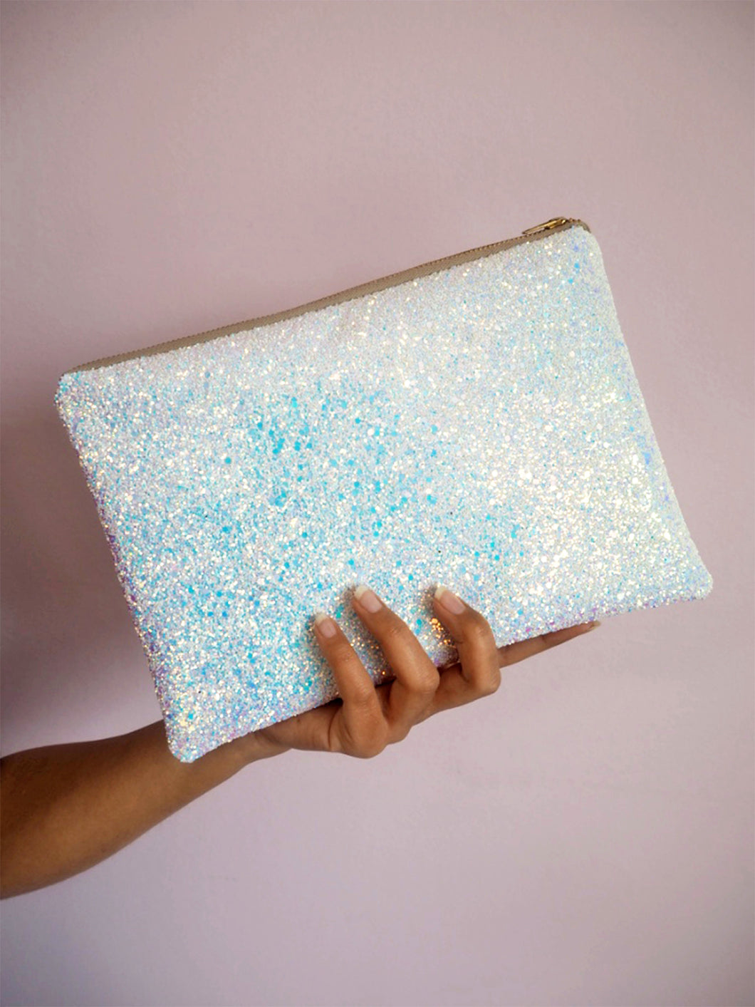white iridescent glitter clutch that's perfect as a wedding bag