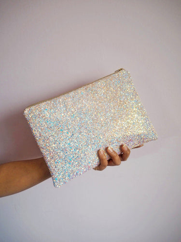 pink iridescent glitter clutch bag