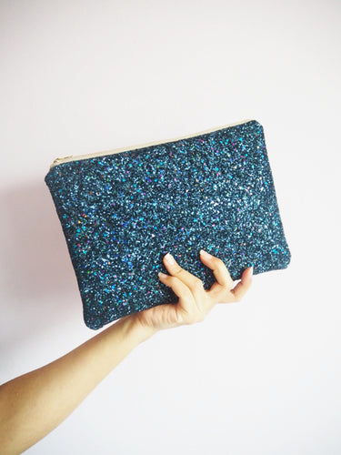 glitter clutch bag in navy rainbow