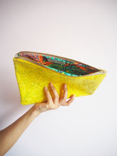 yellow glitter clutch bag