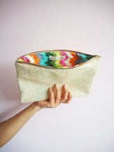 glitter clutch bag in pastel yellow