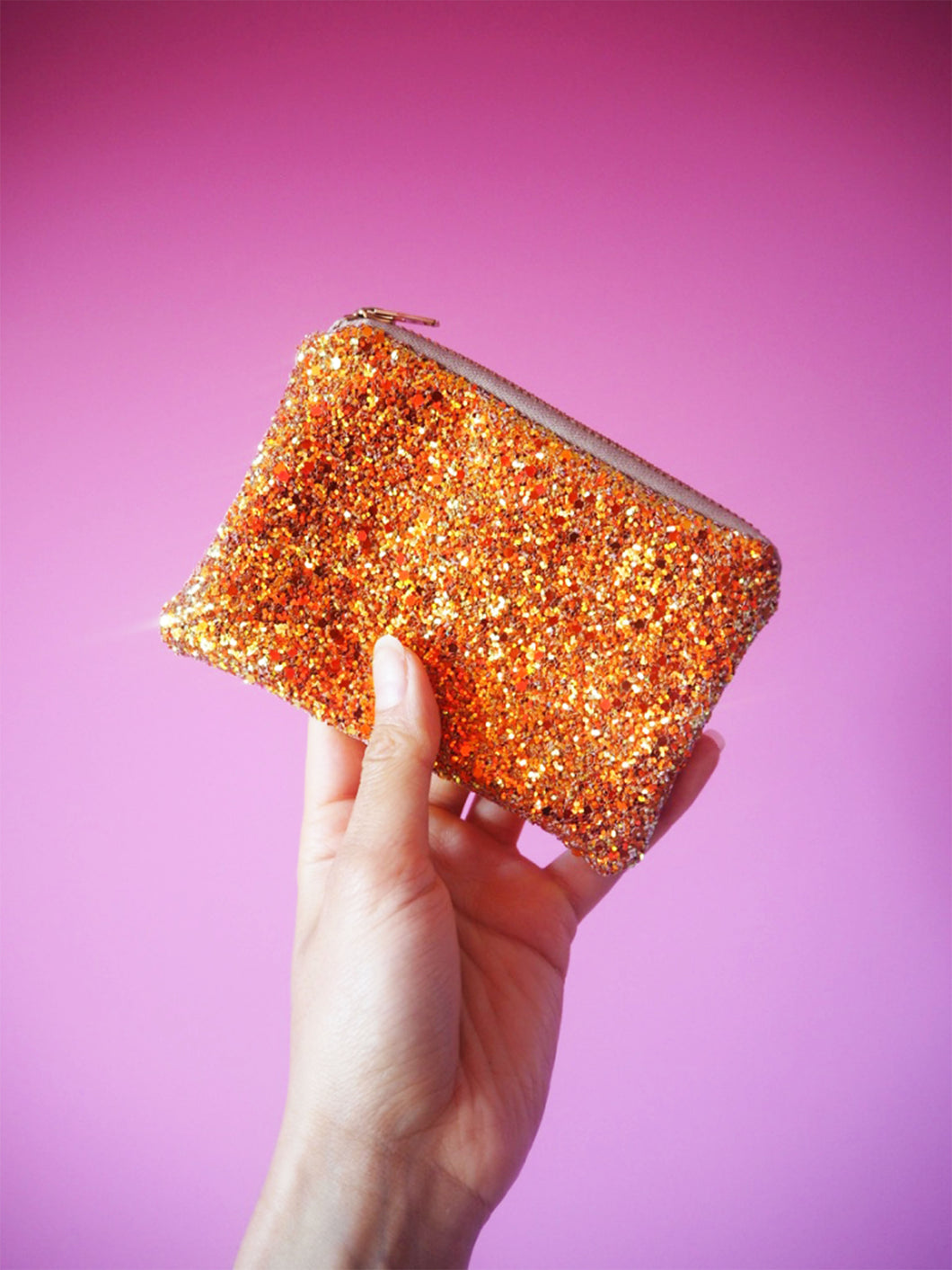 orange glitter coin purse with gold zip