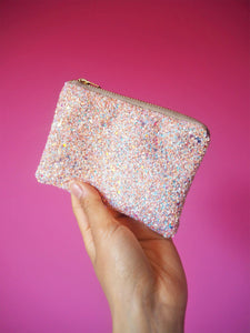 Pastel glitter coin purse with an iridescent sparkle