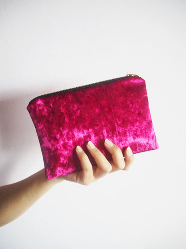 hot pink velvet makeup bag with gold zip