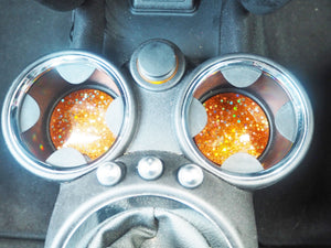 sparkly orange car cup holders