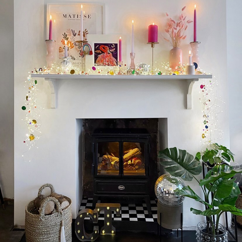 coloured string lights draped along a mantle piece