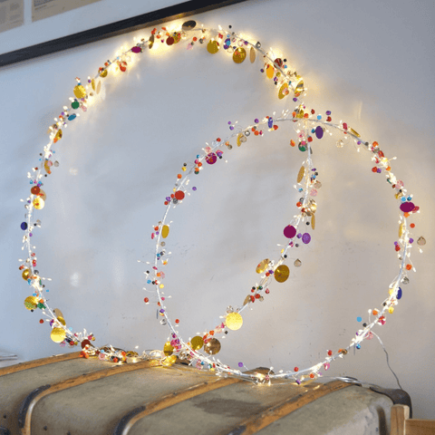 Boho hoop lights placed against a wall