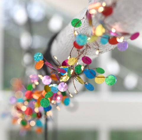 Confetti fairy lights wrapped around a beam
