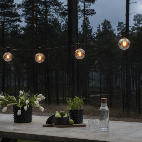 Globe festoon lights hanging over an outdoor table