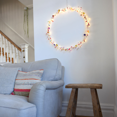 Boho hoop light on a wall in a living room