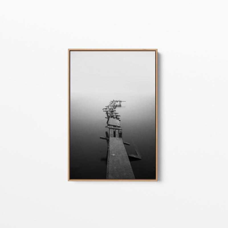 Black Framed picture of a black and white photo of a jetty.