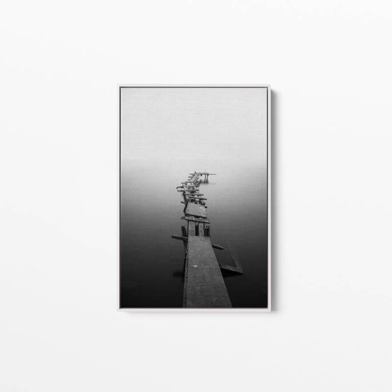 Wooden Framed picture of a black and white photo of a jetty.