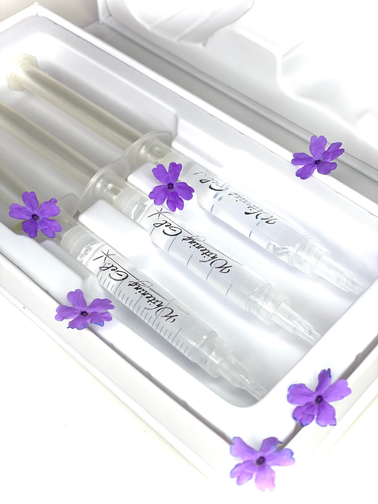 3 Refill Gels inside Kit with six small purple flowers scattered around the syringes