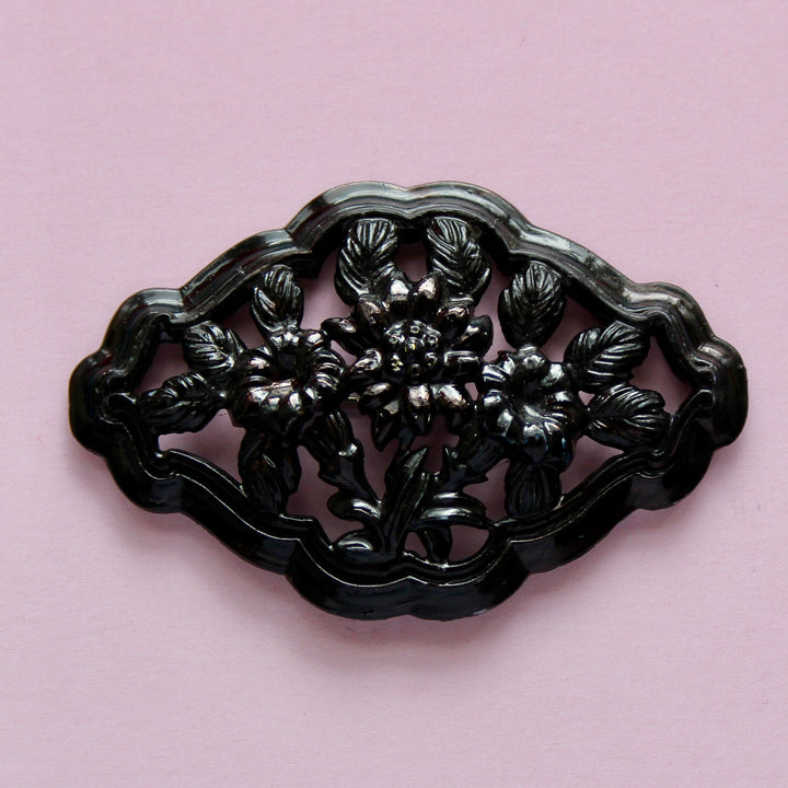 Black Plastic Floral Brooch with Lily