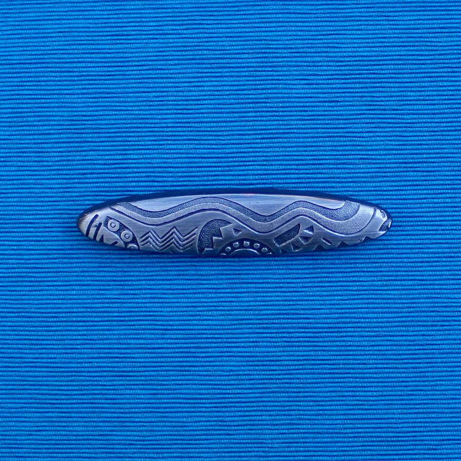 Carved Oval Brooch