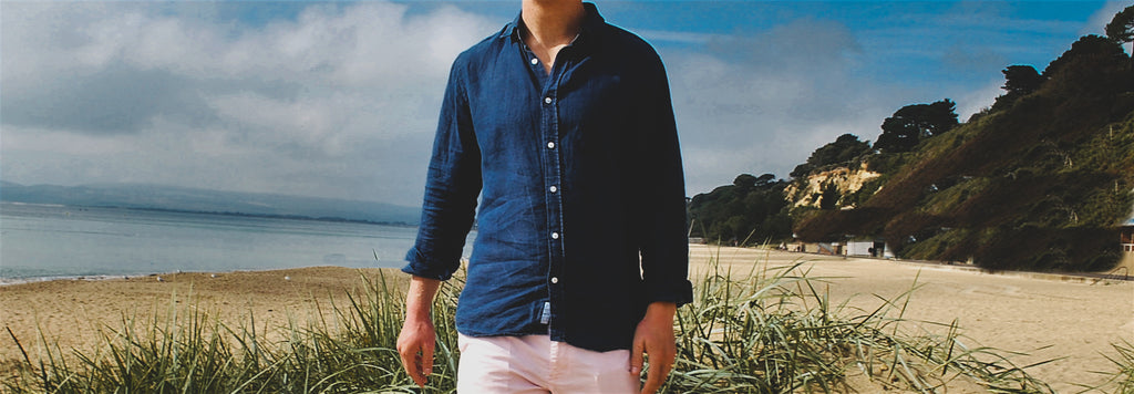 a model wearing his sustainable hemp shirt on the beach