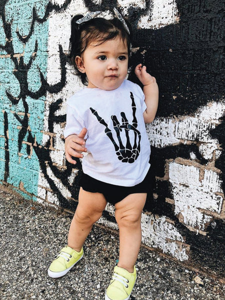 Skull rocker hand on white kids t-shirt.