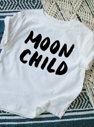 Moon child on white kids t-shirt.
