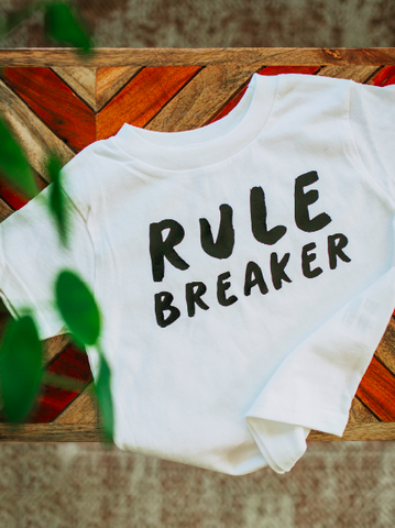 Rule breaker on white kids t-shirt.