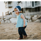 Toddler girl wearing a rain print cotton shirt and unisex blue pants by Amuse Me Shop
