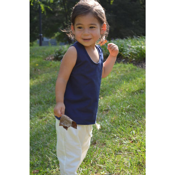 Toddler girl wearing navy blue cotton sleeveless top with white minimal style cotton pants