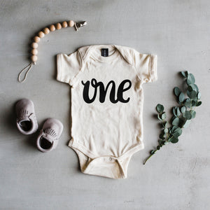 "Load image into Gallery viewer, ""One"" Baby Bodysuit // Cream"