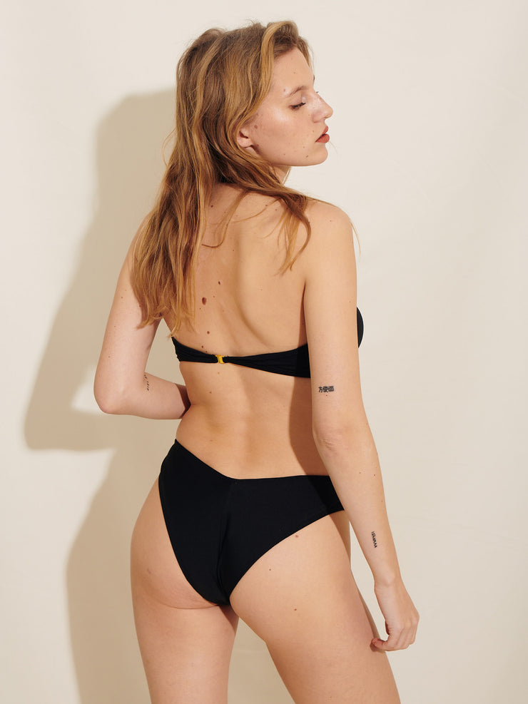 The Melina Bikini Tanga is made in our soft recycled polyester. Sustainable swimwear.